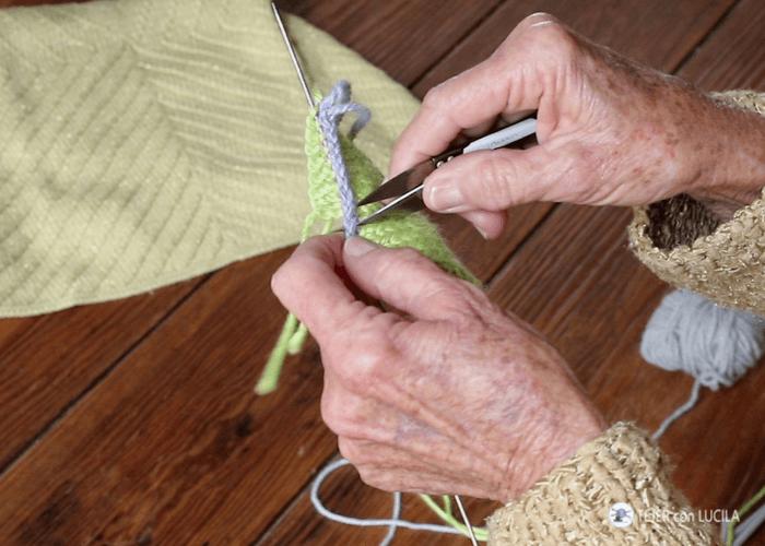 montaje de puntos con lana auxiliar